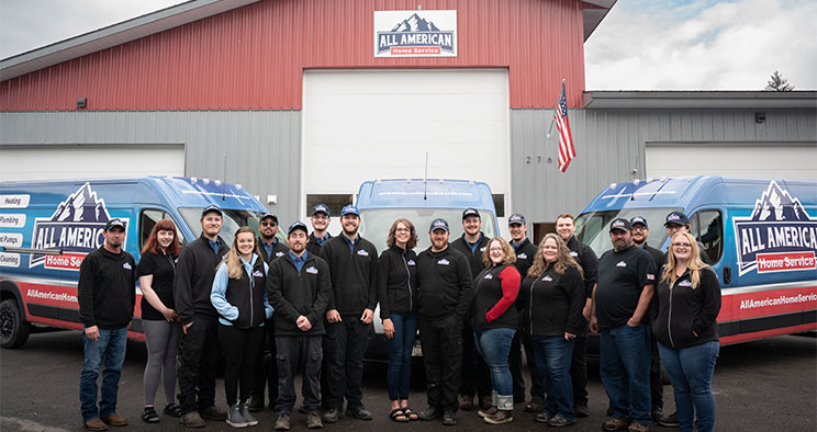 All American Team in Front of Work Vans